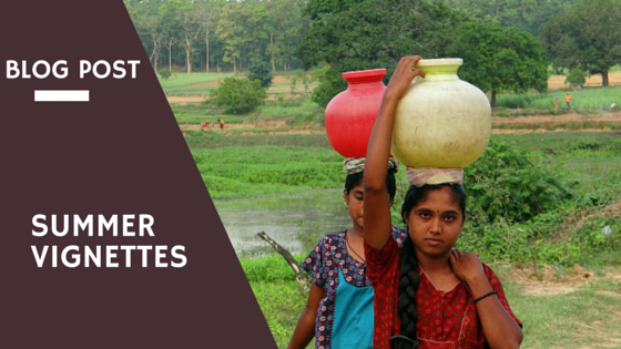 Two girls Carrying home pots of water